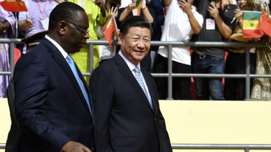 Chinese President Xi Jinping (R) and Senegalese President Macky Sall arrive for the inauguration ceremony of a wrestling arena built by a Chinese company in Dakar, Senegal, on July 22, 2018.