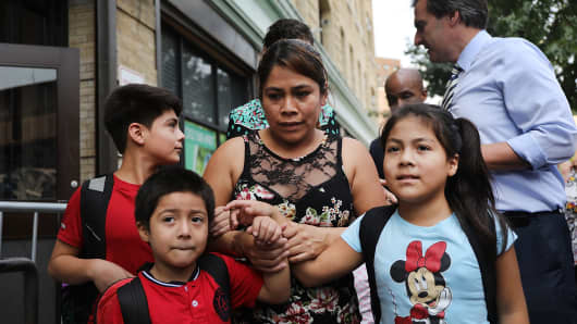 Yeni Maricela Gonzalez Garcia stands with her children after she was reunited with her children at the East Harlem Cayuga Centers on July 13, 2018 in New York City.