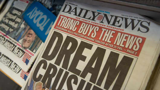 A copy of the New York Daily News sits on the shelf of a newsstand, September 5, 2017 in New York City.