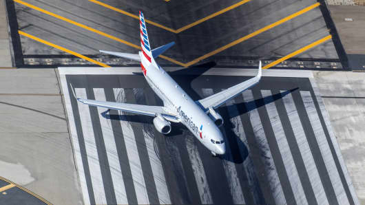 An aerial view of an American Airlines jet preparing to takeoff.