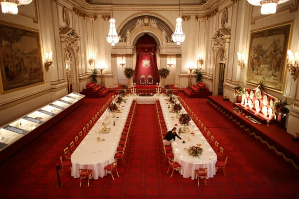Table settings are laid out in the Palace Ballroom for a State Banquet at The Royal Welcome Summer opening exhibition at Buckingham Palace on July 23, 2015 in London, England.