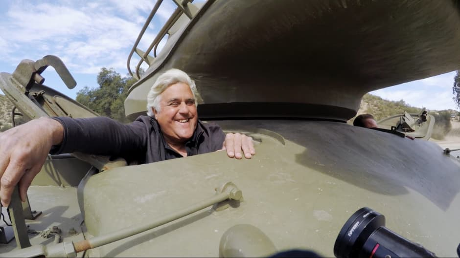 Jay Leno crushes a limo in a tank with Arnold Schwarzenegger