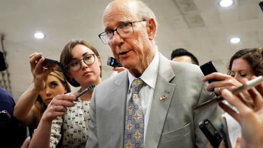 Sen. Pat Roberts (R-KS) speaks with reporters ahead of the weekly policy luncheons on Capitol Hill in Washington, July 24, 2018.