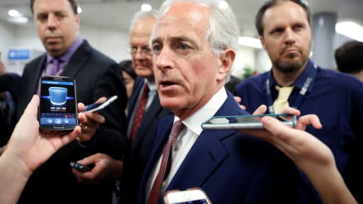 Sen. Bob Corker (R-TN) speaks with reporters ahead of the weekly policy luncheons on Capitol Hill in Washington, July 24, 2018.