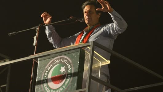 Pakistani cricketer turned politician Imran Khan of the Pakistan Tehreek-e-Insaf (Movement for Justice), speaks to supporters during a campaign rally ahead of the general election in Karachi on July 22, 2018.