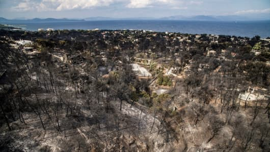 An aerial view shows dammage caused by a wildfire near the village of Mati, near Athens, on July 24, 2018