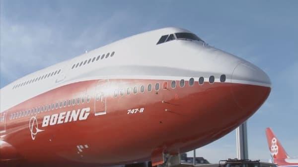 Boeing beats Street, raises full year guidance