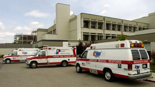 Ambulances are parked outside the emergency room at Good Samaritan Hospital in San Jose, California.