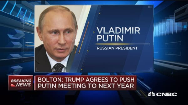 John Bolton: Trump agrees to push Putin meeting to next year