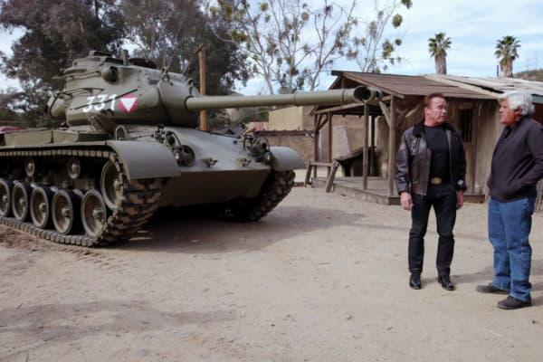 Jay Leno and Arnold Schwarzenegger beside the 1951 M-47 Patton tank