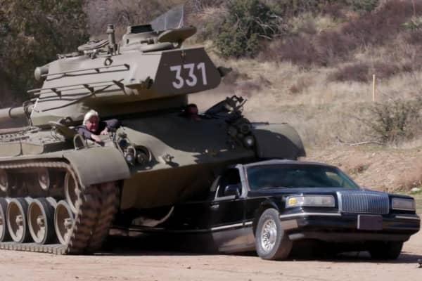 Jay Leno and Arnold Schwarzenegger crush a limousine riding a 1951 M-47 Patton tank