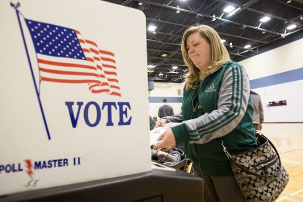 A voter casts her ballot at a polling station in Warren, Michigan.