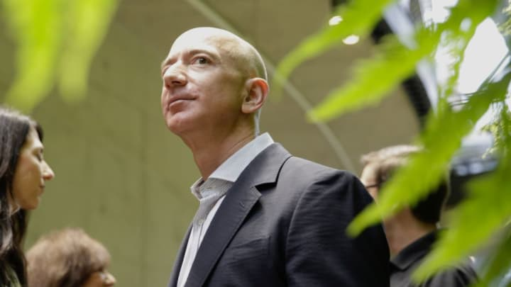 Chief Executive Officer of Amazon, Jeff Bezos, tours the facility at the grand opening of the Amazon Spheres, in Seattle, Washington on January 29, 2018.