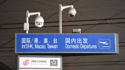 A sign indicates the departure area for flights leaving Beijing airport on July 25, 2018.