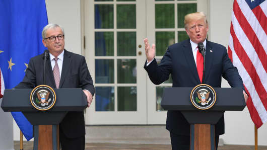 US President Donald Trump and European Commission President Jean-Claude Juncker (L) leave after making a statement in the Rose Garden of the White House in Washington, DC, on July 25, 2018.