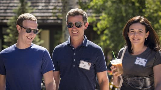 Mark Zuckerberg, chief executive officer of Facebook, Dan Rose, vice president, partnerships at Facebook, and Sheryl Sandberg, chief operating officer of Facebook, attend the annual Allen & Company Sun Valley Conference, July 12, 2018 in Sun Valley, Idaho.