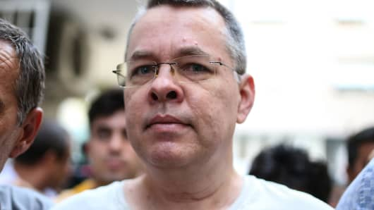 US pastor Andrew Craig Brunson escorted by Turkish plain clothes police officers arrives at his house on July 25, 2018 in Izmir.