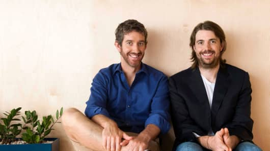 Handout: Atlassian co-founders and CEOs Scott Farquhar and Mike Cannon-Brookes pose for a portrait.