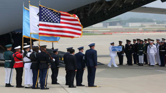 A U.N. honor guards carries a box containing remains believed to be from American servicemen killed during the 1950-53 Korean War after arrived from North Korea, at Osan Air Base on July 27, 2018 in Pyeongtaek, South Korea. North Korea returned the remains of some U.S. soldiers who died during the 1950-53 Korean War on Friday, following through on a promise North Korean Leader Kim Jong-un made to U.S. President Donald Trump when the leaders met in Singapore on June 12.