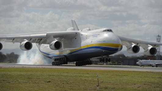 The world's largest aircraft, the Ukraine-built Antonov An-225 Mriya, touches down at Perth Airport on May 15, 2016.    The six-engine aircraft, built to transport the Soviet space shuttle the Buran, is now used for cargo no other plane can handle and on this flight to Perth it has carried a large generator purchased by a Western Australian resources company,  AFP PHOTO / GREG WOOD / AFP / Greg Wood        (Photo credit should read GREG WOOD/AFP/Getty Images)