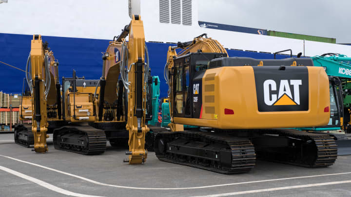 Construction machinery of the US producer Caterpillar can be seen at the BLG Logistics Group Car Terminal, ready for shipping in Bremerhaven, Germany, 12 June 2017. Photo: Ingo Wagner/dpa (Photo by Ingo Wagner/picture alliance via Getty Images)