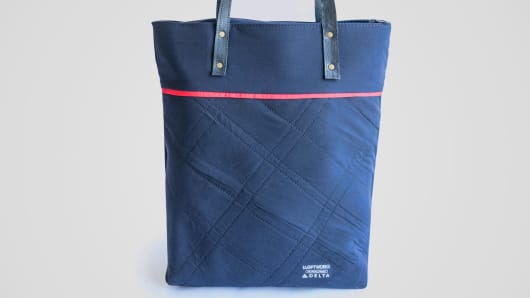 A Delta Airlines bag made from recycled uniforms