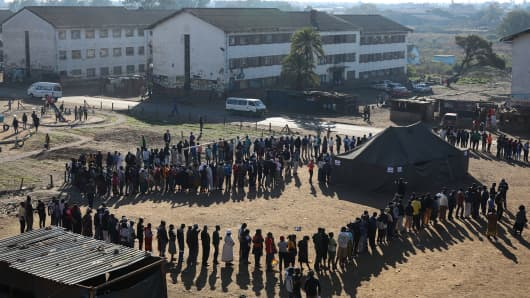 Voters queue at a polling station in the Mbare district of Zimbabwe's capital Harare on July 30, 2018.