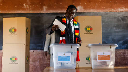 Zimbabwean President Emmerson Mnangagwa casts his ballot at Sherwood Primary School in Kwekwe on July 30, 2018, during general elections.