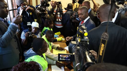 Nelson Chamisa, leader of Zimbabwe's main opposition party Movement for Democratic Change, casts his vote in the Mbare district of the capital Harare on July 30, 2018.