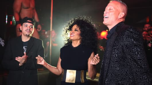 David Cooley (right), owner of LA gay bar The Abbey, with Diana Ross and her musician son, Evan, to promote Ross' new remix of 'Ain't No Mountain High Enough' on January 6, 2018, in West Hollywood, California.