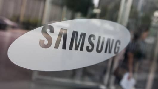 The Samsung Electronics logo is displayed in a window at the company's Seocho office building in Seoul, South Korea.