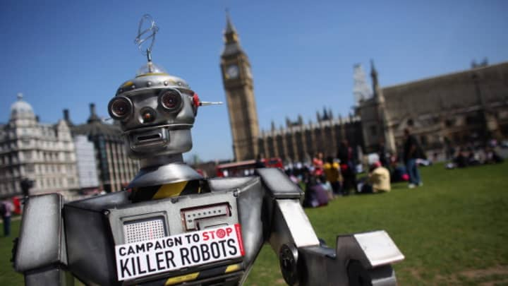 A robot distributes promotional literature calling for a ban on fully autonomous weapons in Parliament Square.
