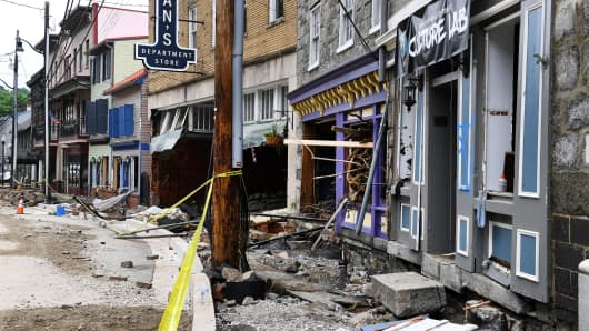 Stores along Main Street sustained severe damage after a storm system dumped over 9-inches of rain in about a two-hour span on Sunday, and workers begin the task of cleaning up May 29, 2018 in Ellicott City, MD. (Photo by Katherine Frey/The Washington Post via Getty Images)