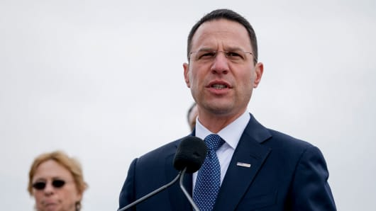 Pennsylvania Attorney General Josh Shapiro, right, accompanied by Maine Attorney General Janet Mills, left, speaks at a news conference near the White House, Monday, Feb. 26, 2018 in Washington.