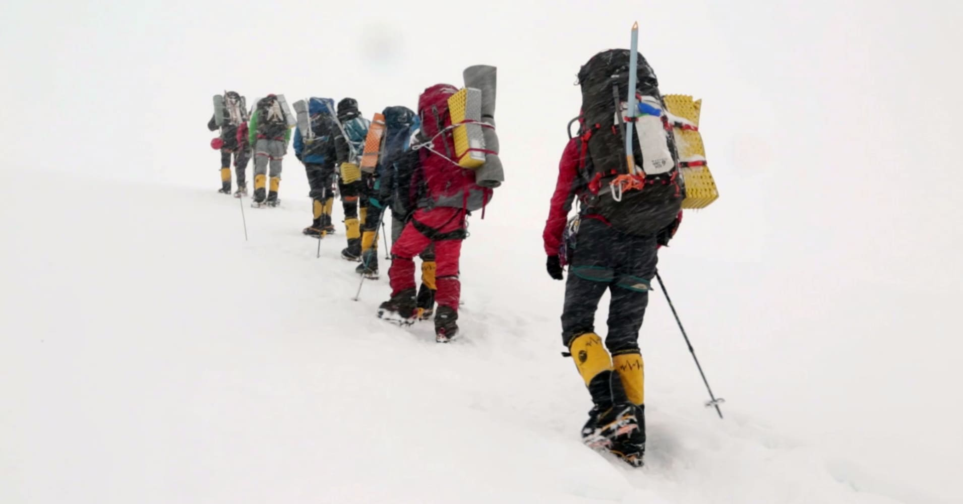 Meet a guide who earns $100,000 a year bringing climbers up the world's most dangerous peaks