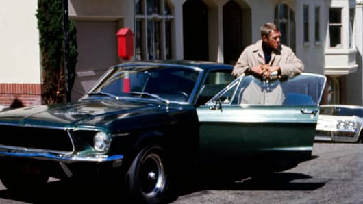 Actor Steve McQueen as Frank Bullit next to a Ford Mustang 390 GT 2+2 Fastback in the movie 'Bullitt', San Francisco, 1968.