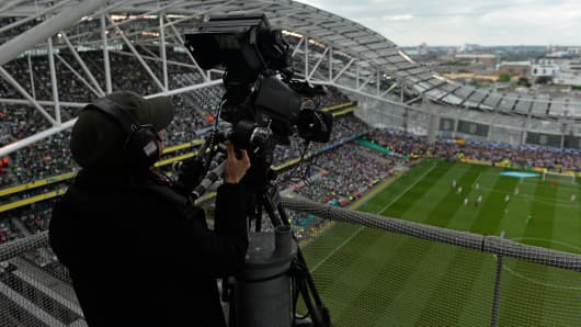 Television cameras in the TV gantry record the game.