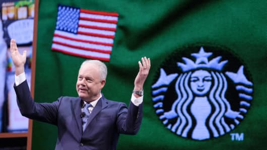 Starbucks CEO Kevin Johnson gestures while speaking during the Starbucks annual shareholders meeting at McCaw Hall on March 21, 2018 in Seattle, Washington.