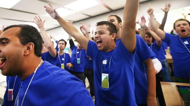 Employees celebrate opening of Apple store in Rio de Janiero, Brazil