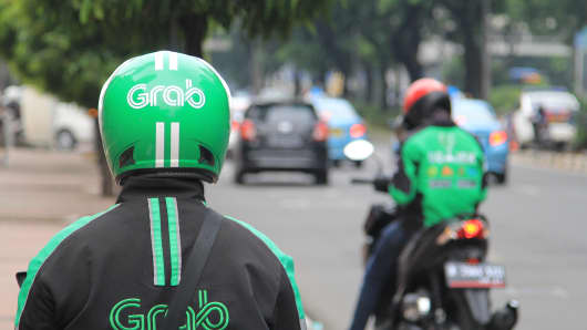 Indonesia Grab bike riders waiting for passengers in Jakarta.