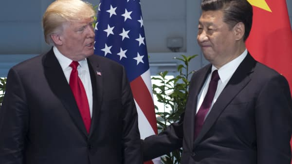 President Donald Trump, left, and China's President Xi Jinping arrive for a meeting on the sidelines of the G-20 Summit in Hamburg, Germany.