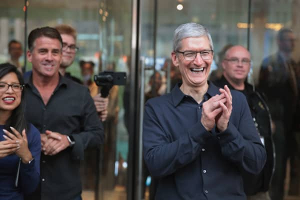 Apple CEO Tim Cook greets guests at the grand opening of Apple's Chicago flagship store on Michigan Avenue in Chicago, Illinois.