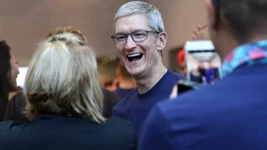 Apple CEO Tim Cook greets customers as they prepare to purchase a new iPhone X at an Apple Store on November 3, 2017 in Palo Alto, California.