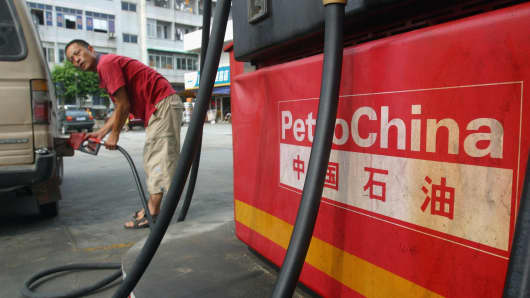 A driver fills his car at a PetroChina gas station in Guangzhou, China.