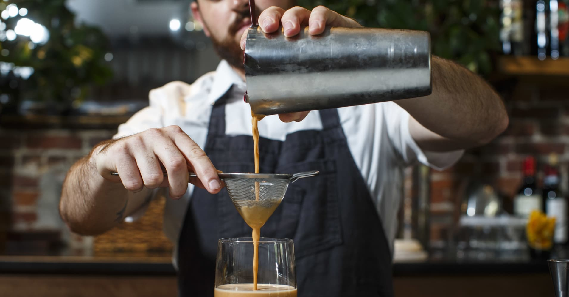 A bartender makes a drink in Boston