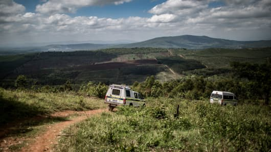 South African police respond to an incident in which a farm worker was held at gunpoint and a chainsaw was stolen on November 2, 2017, in Tzaneen, South Africa.