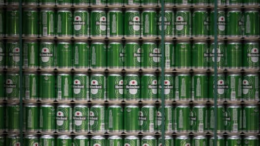 Heineken beer cans sit stacked at the Heineken NV brewery in Zoeterwoude, Netherlands.