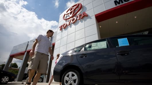 People look at a new Toyota Prius at Mountain States Toyota in Denver, Colorado.