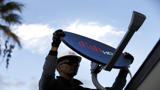 A Dish Network Corp. field service specialist installs a satellite television system at a residence in Downey, California.