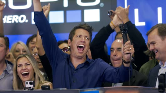 Nick Woodman, founder and chief executive officer of GoPro Inc., center, cheers while ringing the opening bell for the release of the company's IPO at the Nasdaq MarketSite in New York, U.S., on Thursday, June 26, 2014.